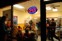 Holiday Stroll participants gather to enjoy refreshments at Empanadus, a restaurant in downtown Riverside.