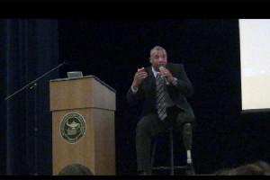 John Register talks perseverance with student body