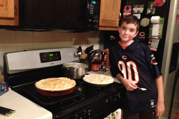 Freshman Erik Robertson poses by his stove at home.  Robertson loves to cook and even plans to become a chef after school.