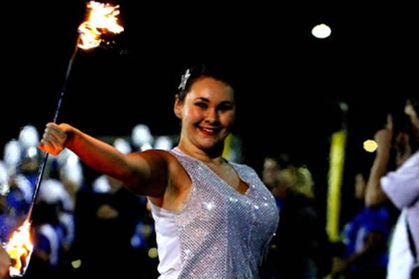 Senior Natalie O'Callaghan twirls fire baton at RB's Homecoming.  Whether twirling or planning to teach, O'Callaghan loves the feeling of being on stage.