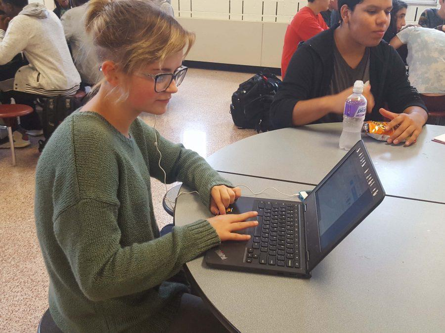 Sophomore%2C+Sophia+Doty%2C+working+on+homework+on+her+chromebook+during+lunch.+