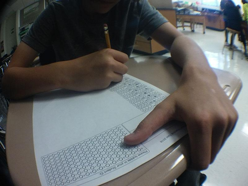 Garrett+Wiemer+takes+a+Biology+exam.