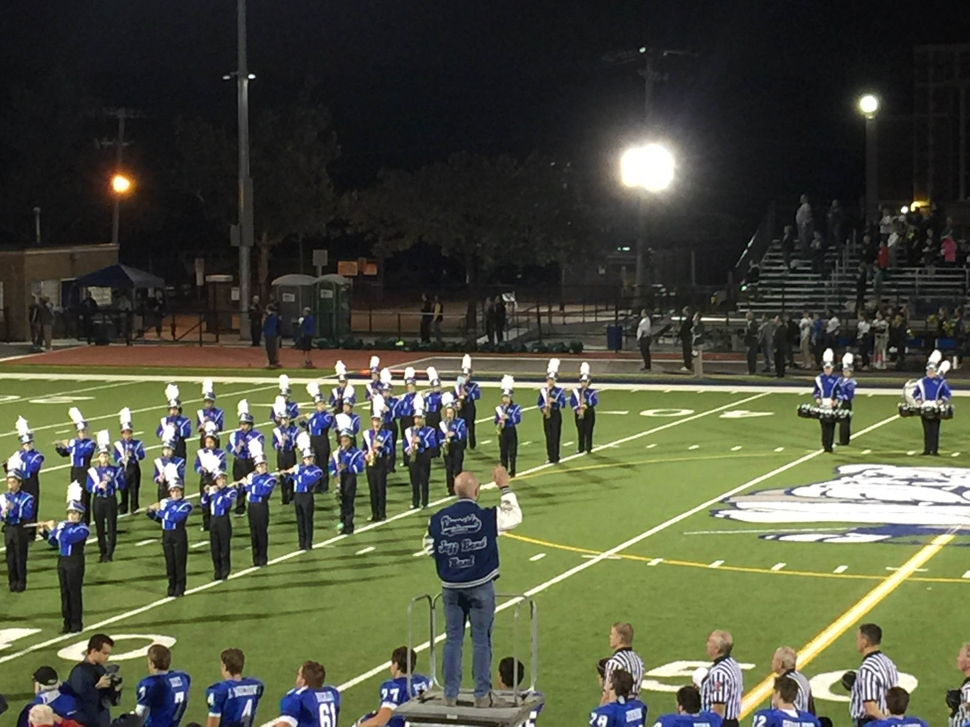 James Baum conducting the high school band during an RB football game.