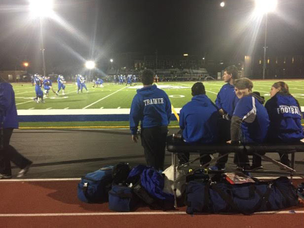Student+athletic+trainers+in+action+during+a+RB+home+football+game.