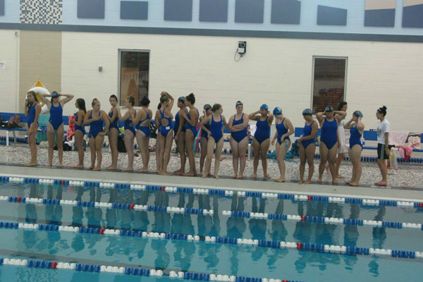 Girls swimming lines up.