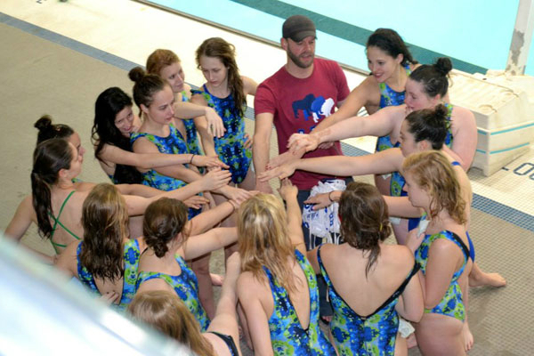Stephany and her water polo team huddling up.