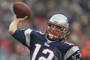 Tom Brady throws a touchdown pass against the Dolphins