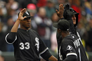 Edwin getting the W and Juan Pierre giving him a high five for his job well done.
