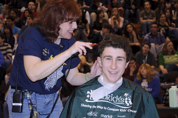 Students and staff shave off hair for cancer research