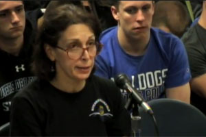 Carol Moon, mother of two water polo players, speaks to the board about the importance of keeping water polo.