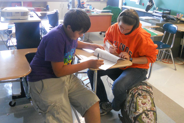 Here, Senior National Honors Society member, Christina Sauer, helps to tutor Sophomore, Jacob Koerner, with his homework.  A great example on how National Honors Society can help RB bulldogs with their homework.