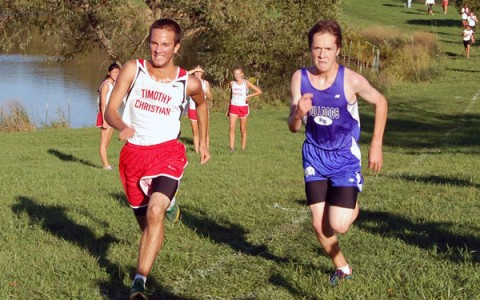 Junior Ian Clark sprints to the finish as he battles with a runner from Timothy Christian