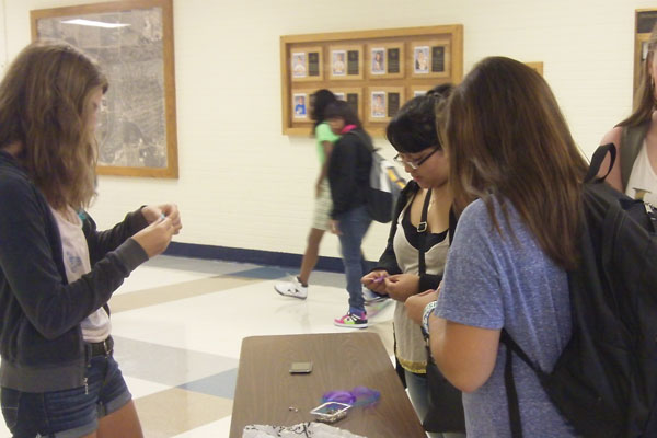 To raise awareness about the effects of depression, members of Erika's Lighthouse passed out purple and blue ribbons to students before school on Wednesday.