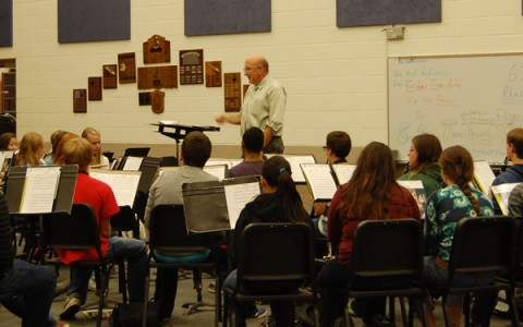 McOlgan had been a teacher at RB for nineteen years. Above, he practices a piece with the Honors Symphonic Marching Band