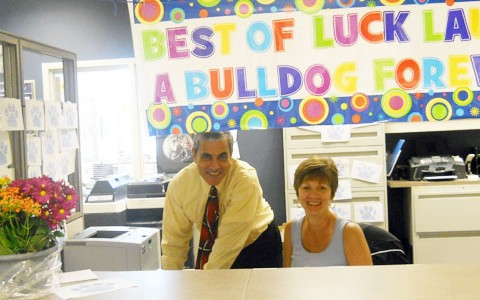 Administrative Assistant Lauren Presta and Assistant Principal John Passarella pose together on Presta's final day at RB.  Presta will be accepting another position in District 88.