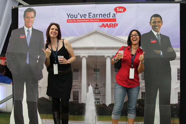 Political ads often don't tell the whole truth about candidates. Above, voters pose with cutouts of the candidates during the debates.