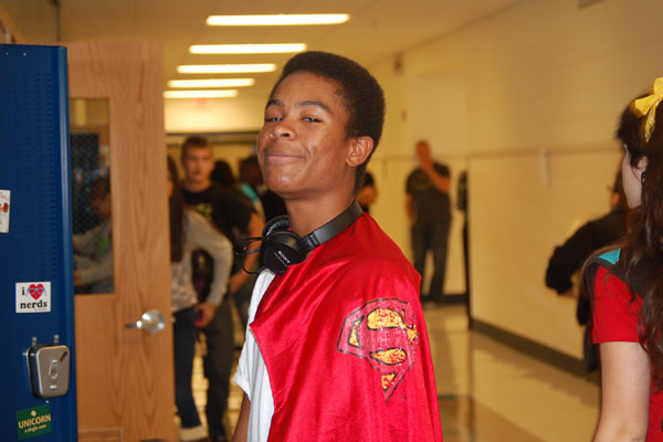 Sophomore Marvin McKenzie shows off his stylish Superman cape for Superhero Monday.  Other Spirit Week days include Decades Tuesday, Sport Wednesday, Endless Summer Thursday, and Crazy Blue 'n White Friday.