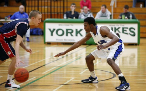 Senior guard, Eric Loury, goes to work on defense against Conant.