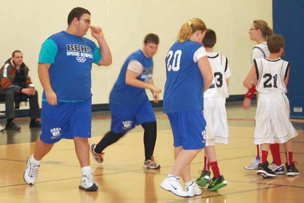 Special Olympics athlete Mike Habayeb (left) would claim his moment of fame at half-time with a jaw dropping half-court shot.