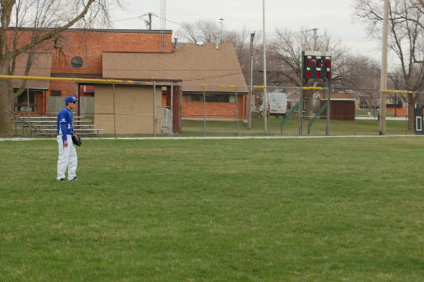Senior Outfielder Luke Keller awaits a flyball in a conference matchup against the Ridgewood Rebels.