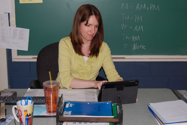 SEE Team Math Teacher Patty Young plans lessons and maintains her calendar on her iPad.  SEE Team's iPads are one of many new personal technology device inclusions at RB.