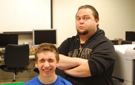 New auditorium manager Matt McConnell clowns around with senior tech crew member Findlay Ross.