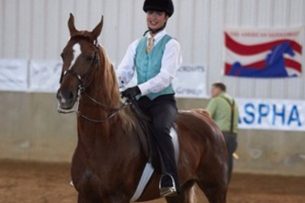 Escobedo, shown here riding her horse Lucy, has been riding competitively for four years.