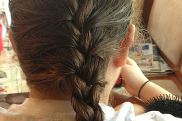The French Braid is a hair style that can be worn to keep hair out of students face.