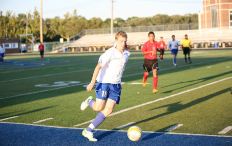 Sophomore James Kaczmacyk dribbles the ball up the sideline.