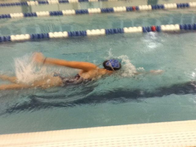 Senior Sydney Veon swimming freestyle.