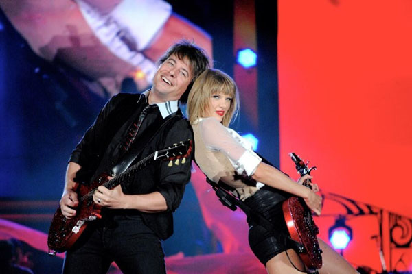 Taylor Swift and her band mate rocking out at their concert at soldier field in Chicago!