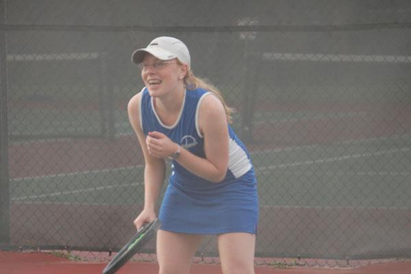 Senior Kristen Tomacek gets ready to return a serve