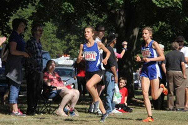 German exchange student, Mailin Struck, (right), leads the way for a stacked girls' cross country team.