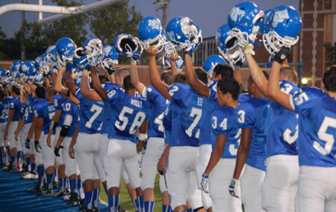Football players still hold helmets high, even in the midst of their most recent heart wrenching loss to Ridgewood