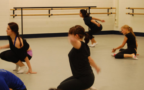 The Repertory Dance Ensemble is practicing for the Winter Concert.