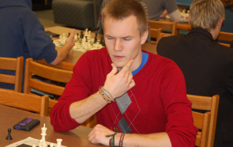 Chess Club member Vidas Kulbis thinks intensely about his next move.
