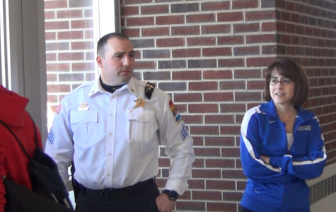 Principal Pam Bylsma stands next to an area police officer as students exit after last week's soft lockdown.  Bylsma is leaving RB at the end of June to become an assistant superintendent for the Hinsdale 86 school district.