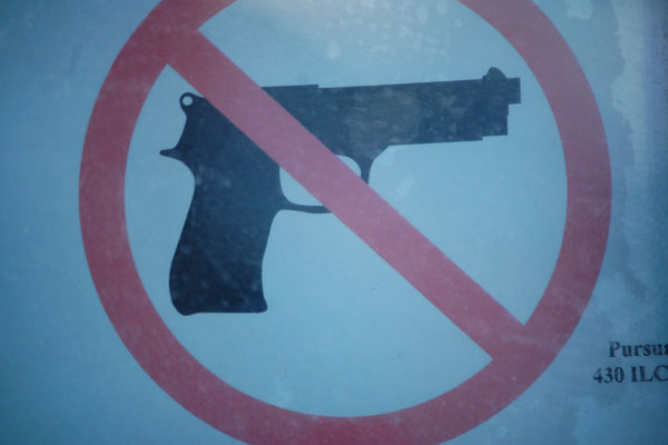 Locked doors, anti-gun signage new signs of school security