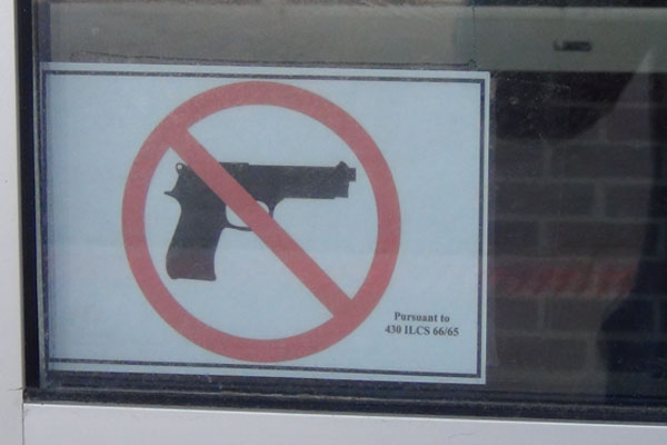 Signs prohibiting concealed-carry in a high school are posted at RB's doors.  Do these signs deter gun violence or encourage it?