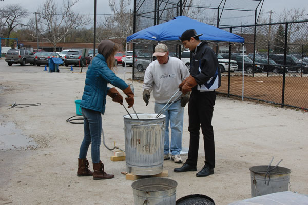 Once the weather permitted, Ceramics students took to the baseball field to try their hand at Raku firing.