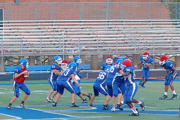 Right after the hike, the boys get ready to defend the quarterback.