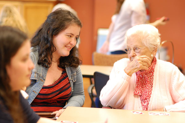 Residents of the Cantata and AST students share a visit together.