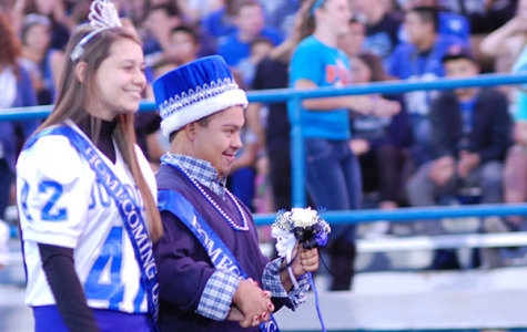 Homecoming Queen, Kate Kosner, and Homecoming King, Josh Sylvie, walking to their seats before the game.
