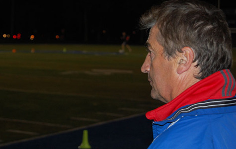 Soccer Coach Danny Makaric looks on as the boys team practices. Many of the athletes have known Makaric from a young age.