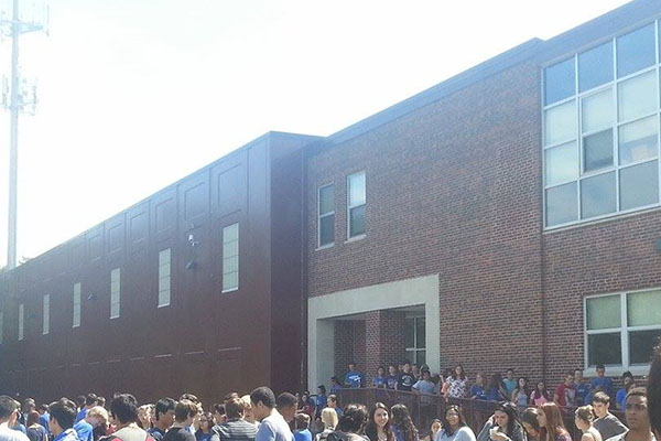 Students file out of school during an unannounced fire drill