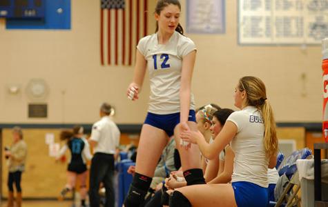 Sophomore, Dana Rettke, high fives teammate Natalie Wanner.