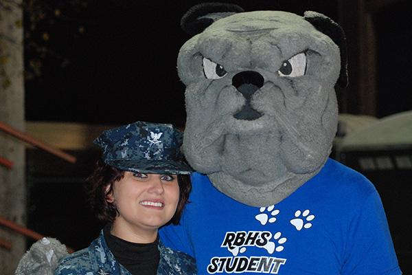 Rouser standing with a Navy service woman.