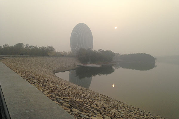 Yanqi Lake, a scenic area north of Beijing, is one venue for the APEC summit. This photo, shot about 3 p.m. on Saturday, Oct. 25, 2014, shows the area shrouded in intense pollution. (Julie Makinen/Los Angeles Times/MCT)