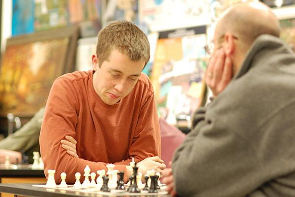 Senior Chris Detloff plays a close game against Chess Club sponsor, Mr. Monti.