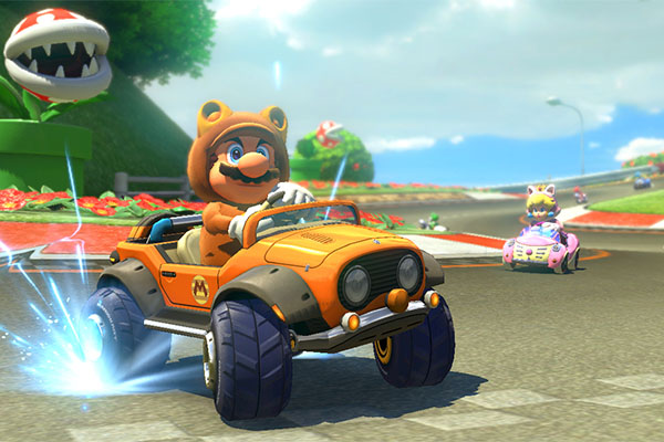 Tanooki Mario and Cat Peach race along Yoshi Circuit, a returning course from Mario Kart: Double Dash. The track and the characters are new with the DLC set.